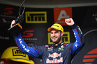 Shane Van Gisbergen holds the Jason Richards Trophy. Photo / Getty Images