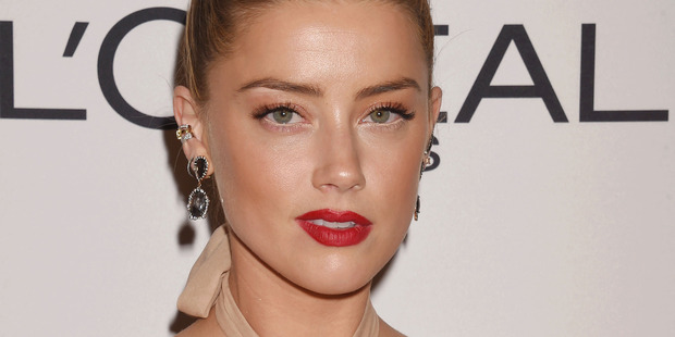 Amber Heard is being sued for US$10 million for refusing to appear nude in controversial film London Fields. Photo/Getty Images