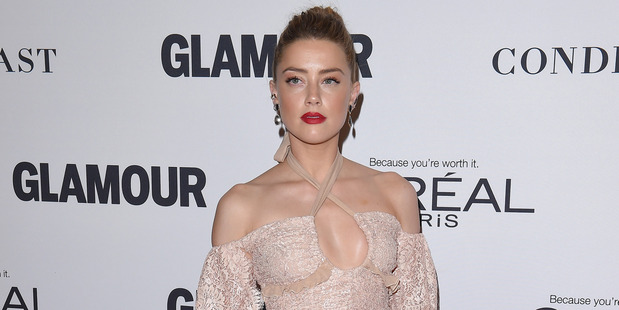 Amber Heard has spoken out about her struggle with domestic violence in a bid to help others. Photo / Getty Images