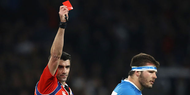 Referee Pascal Gauzere of France shows Enrique Pieretto of Argentina a red card. Photo / Getty