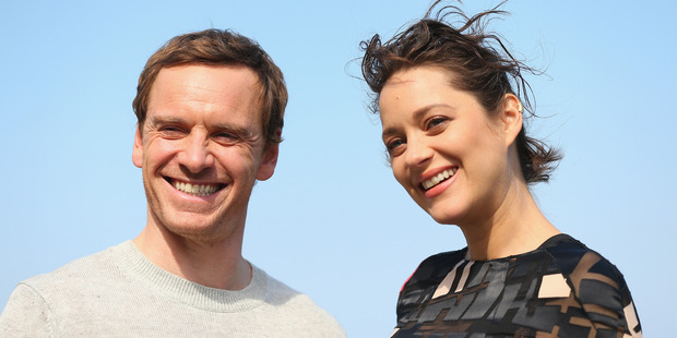 Michael Fassbender & Marion Cotillard pose during a photo call for Assassin's Creed. Photo / Getty