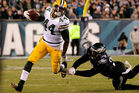 James Starks of the Green Bay Packers outruns Marcus Smith of the Philadelphia Eagles. Photo / Getty
