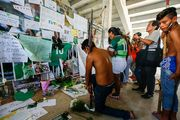 A group of people pay tribute to the players of Brazilian team Chapecoense Real at the club's Arena Conda stadium in Chapeco. Photo / Getty Images