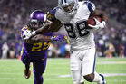 Dez Bryant of the Dallas Cowboys fends off Xavier Rhodes of the Minnesota Vikings to score a go-ahead touchdown in the fourth quarter. Photo / Getty