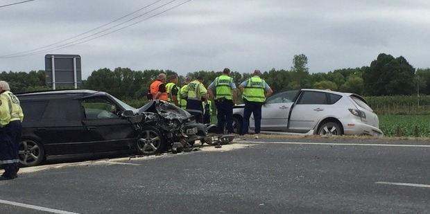 Emergency services are at the scene of a two car collision near Fernhill Bridge this morning.