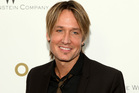 Keith Urban used to smoke crack in his drug dealer's bathroom, according to an interview with his former supplier David Dobson. Photo / AP