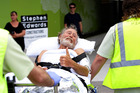 The 65-year-old Shark attack victim from Tuncurry arrives by Westpac rescue chopper at Newcastle's John Hunter Hospital. Photo / Peter Lorimer / News Limited