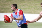 LOVING IT: St Kilda player Jarryn Geary, left, in possession training at Bay Oval yesterday. PHOTO/ANDREW WARNER