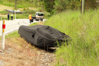 Crashed McLaren F1 on the Glenorchy-Queenstown road today. Photo / Otago Daily Times