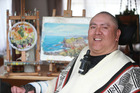 Mouth artist Wayne Te Rangi's painting has been used to illustrate a Christmas card and will be sold worldwide. Photo / Doug Sherring