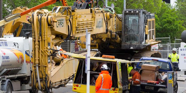 Loading The 85-tonne ultra-high-reach excavator that will be used to demolish the office tower at 61 Molesworth St. Photo / Mark Mitchell