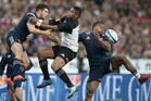 All Blacks winger Waisake Naholo competes for the high ball against France's Brice Dulin and Virimi Vakatawa during the test match between the New Zealand All Blacks and France. Photo / Brett Phibbs.