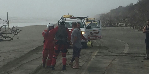 Rescue helicopter staff at the scene of a fatal boating accident at South Head on the Kaipara Harbour. Photo / Auckland Westpac Rescue Helicopter