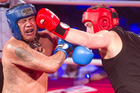 The Red team's Andrew Totten (right) throws a punch to the head of the Blue's Matty Rowberry at the 2016 Christmas with a Punch corporate charity fight night. PHOTO/STEPHEN PARKER.