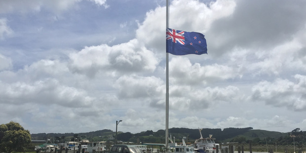 Flag flies at half mast at the Helensville Cruising Club. Photo / Michael Craig