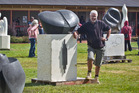 ART: Rotorua's Trevor Nathan with his winning sculpture at the 2016 Sulphur Lake Sculpture Symposium. PHOTO/STEPHEN PARKER