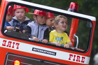 FUN: Tyga Yamada, 3 (from left), Hikaia Ruha, 5, Braxton Sarusi-Kiss, 3, Arran Ruha, 3, and Max Aislabie, 3, enjoyed a ride in a kid-sized fire truck. PHOTO/STEPHEN PARKER