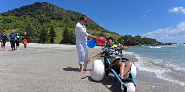 Loading Ocean lover Josh Laforteza, with father Peter Laforteza, about to dip his toes in the ocean. Photo/George Novak