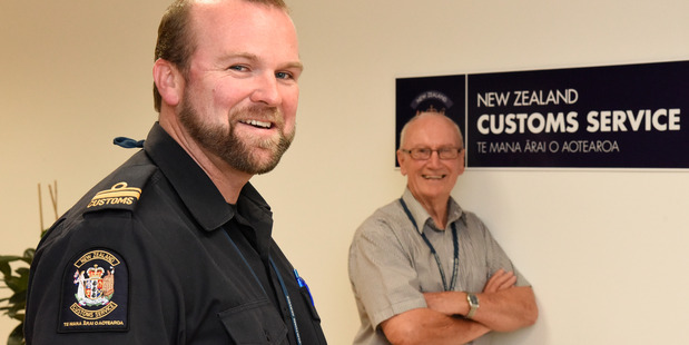 Loading Mike Farnworth (right) is retiring from Customs after almost 55 years in the job, with Chief Customs Officer Jamie Hickey who takes over the reigns. Photo/George Novak.
