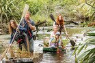 Stu Muir and Kim Jobson's children help with native plant restoration planting among the tidal wetlands of the lower Waikato delta. Photo / Rob Suisted