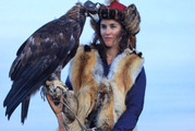 Chloe Phillips-Harris, 28, pictured holding an eagle and riding a horse in Mongolia, who was detained in Kazakhstan when officials. Photo / Supplied