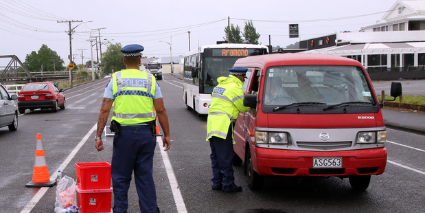 Constables Tama Dalbeth and Ivan Madder stop cars for a car seat check on Somme Pde. PHOTO/STUART MUNRO