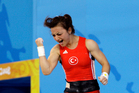 FILE - In this Saturday. Aug. 9, 2008 file photo, Sibel Ozkan of Turkey celebrates after lifting 111 Kg in the clean and jerk to win the silver medal during the women's 48 kg category. Photo / AP.