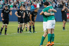 Ireland's Joey Carbery, right, celebrates with Josh van der Flier, left, after a rugby match against New Zealand, Saturday, Nov. 5, 2016, in Chicago. (AP Photo/Kamil Krzaczynski)
