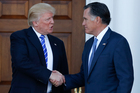 President-elect Donald Trump and Mitt Romney shake hands as Romney leaves Trump National Golf Club Bedminster in Bedminster, N.J. Photo / AP