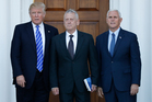 President-elect Donald Trump and Vice President-elect Mike Pence pose for photographes with retired Marine Corps Gen. James Mattis. Photo / AP