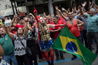 Demonstrators shout outside the state of Rio de Janeiro's legislative assembly building where lawmakers are discussing austerity measures in Rio de Janeiro, Brazil. Photo / AP