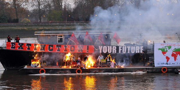 Joe Corre, the son of Vivienne Westwood and Sex Pistols creator Malcolm McLaren, burns his 5 million pound punk collection on a boat on the River Thames in London. Photo/AP