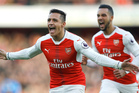 Arsenal's Alexis Sanchez, left, and Arsenal's Theo Walcott celebrates after scoring during the English Premier League soccer match between Arsenal and Bournemouth. Photo / AP