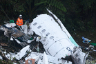 Rescue workers search at the wreckage site of the plane that crashed carrying the Brazilian first division soccer club Chapecoense team. Photo / AP