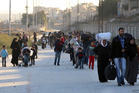 People flee rebel-held eastern neighborhoods of Aleppo  earlier this week  into the Sheikh Maqsoud area of Syria controlled by Kurdish fighters. Photo / AP