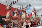 Father Christmas flies down High St on the Lions Club float at a Dannevirke Christmas Parade. Photo / Christine McKay