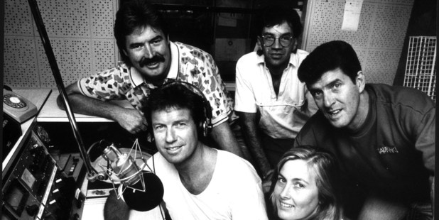 John Hawkesby at the microphone with other Radio Hauraki staff including Phil Gifford, Phil Yule, Kevin Black and Julie Collier.