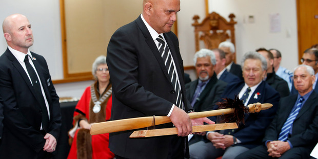 New Zealand Maori rugby development manager Tiki Edwards delivers the taiaha which will act as a trophy in the British and Irish Lions tour next year. Photo / Michael Cunningham