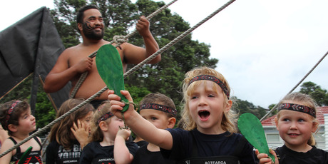A little warrior from Paihia-Waitangi Kindergarten gives Maui some vocal support as he slows down the sun during last year's Paihia Christmas parade. PHOTO / Peter de Graaf