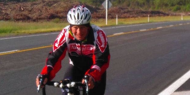 Extreme enduro rider Colin Anderson cresting Hatepe Hill near end of the 7th lap of his Lake Taupo Challenge.