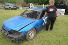 Pam Fisher flying the Taipa Speedway flag at the Wheels of Mayhem carshow in Kaitaia earlier this month.