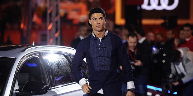 Cristiano Ronaldo of Real Madrid gets into his Audi RS Quattro car for the 2016/2017 season at Carlos Sainz Center. Photo / Getty Images