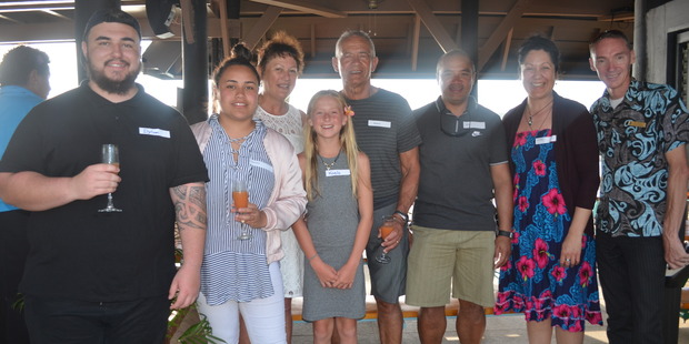 Mike Burgoyne with his family, including wife Caroline to his right, and staff of Shangri-La Fijian Resort during his recent trip.