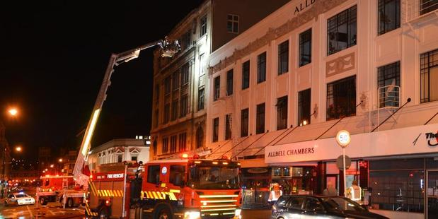 Crews were called to the building in lower Stuart St just after 4am. Photo / Stephen Jaquiery