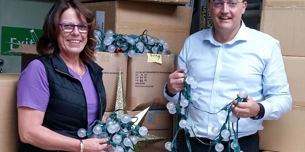 Shirley Murphy from InDeserve (left) and Hamilton Christmas Charitable Trust chair Simon Scott with the new lights.