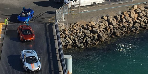 The luxury cars board the Kaitake ferry this morning. Photo / @GeorgeKCampbell Twitter