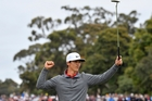 Dane Thorbjorn Olesen celebrates after sinking his putt on the 18th green yesterday. Photo / AP