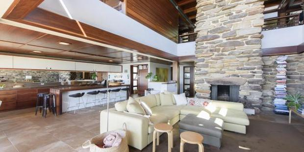 The lounge area and imposing stone fireplace in the sprawling beach pad. Supplied by Foxtel