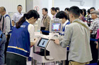 Foreign visitors use biocarts for entry procedures at Takamatsu Airport in October. Photo / The Japan News-Yomiuri