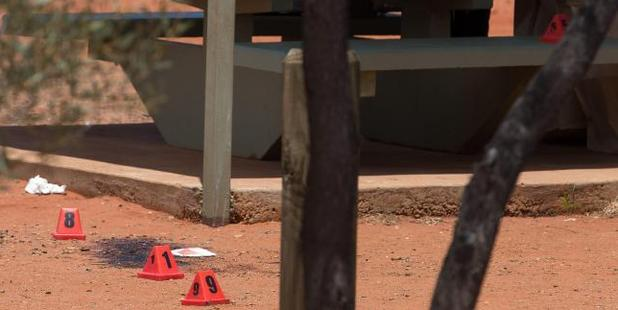 Evidence markers at the scene of the stabbing. Photo / News Corp